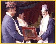 Rajan receiving an appriciation letter from Tourism minister